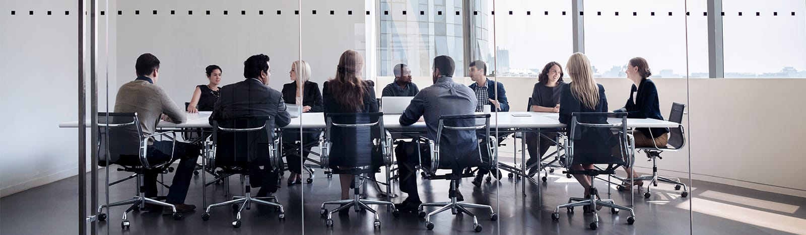 Group of people around a conference table