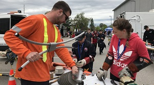 crews show safety equipment to students