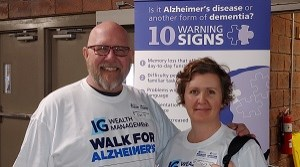 two employees volunteering with Alzheimers society